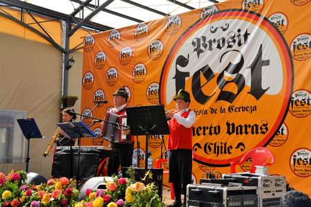 Puerto Varas, Chile - 18 January 2013: Musicians play traditonal German Blasmusik at Prosit fest, an Octoberfest style German festival in a beer tent in Puerto Varas. Descendants of German settlers are still practising their traditions in Southern Chile a Editorial