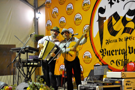 Puerto Varas, Chile - 19 January 2013: Musicians play traditonal German Blasmusik at Prosit fest, an Octoberfest style German festival in a beer tent in Puerto Varas. Descendants of German settlers are still practising their traditions in Southern Chile a Editorial
