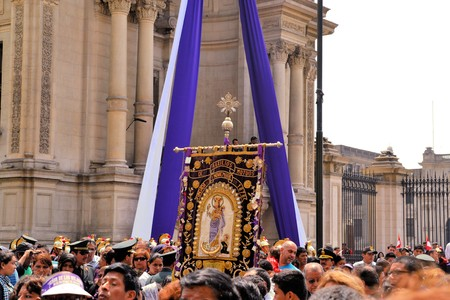 Lima, Peru - 18 October 2012: Idol of Lord of Miracles, one of the largest religious processions in the world. October is called Purple Month in Lima for the rich purple robes worn by the faithful catholics, who carry the centuries-old image of El Senor d