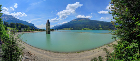 Reschensee Lake in South Tyrol, Italy, near Austria and Switzerland. Stock Photo