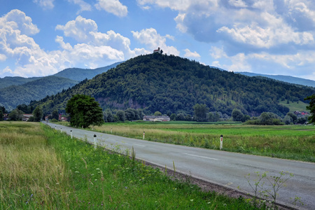 A church sits atop a green hill on a sunny day outside of Ljubljana, Slovenia