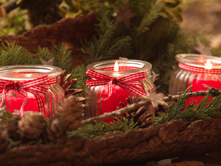 three burning red candels - christmas deco Stock Photo