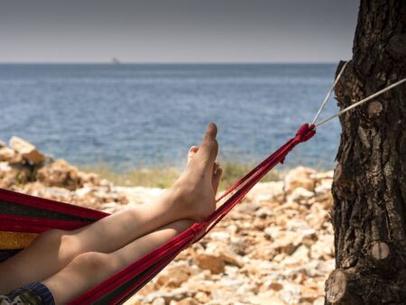 image shows how to relax or chill in hammock with nice seaview or ocean view and beach - best for travel agency or holiday planer