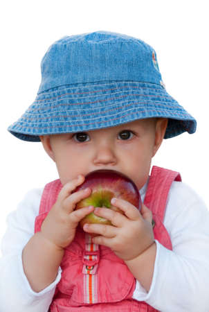 Baby girl holding big red apple. Isolated on white, Clipping Path included, close up photo