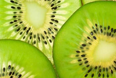 Slices of ripe kiwi fruit (close up,transparent) photo