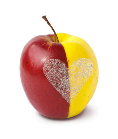 Two halves of apples merged together as a whole with silver heart on white background