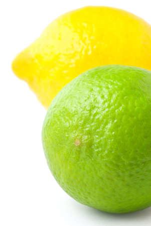 Close up of fresh green lime and lemon isolated on white background  Stock Photo