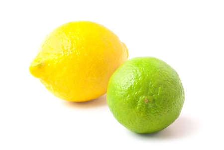 Close up of fresh green lime and lemon isolated on white background. Please visit my portfolio for similar pictures.