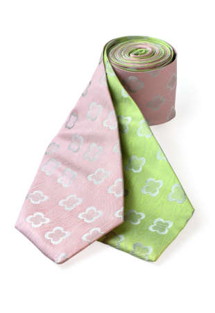 Green and pink ties wrapped together on white background. Please visit my portfolio for similar pictures. Stock Photo