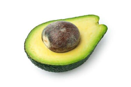 Close up of half ripe avocado with seed isolated on white