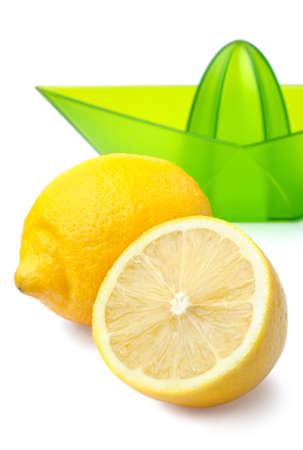 Close up of fresh lemons and lemon juicer isolated on white background