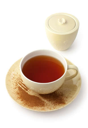 Cup of tea with saucer and sugar bowl on white background  Stock Photo
