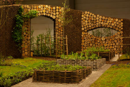 Ghent, Belgium - April 23, 2010: The Ghent Floralies (de Gentse Floralien ) 34th edition of prestigious flower and plant exhibitions on April 17-25, 2010 in Ghent (Gent), Belgium. Wooden wall Editorial