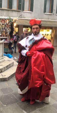 vemise, carnival,single man costumed in pope