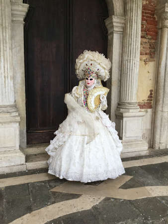 Venise carnival lady in the white costume Stock Photo