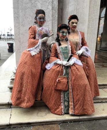 Trio of ladies costumed