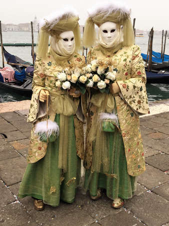 couple costumed for venise carnival Editorial