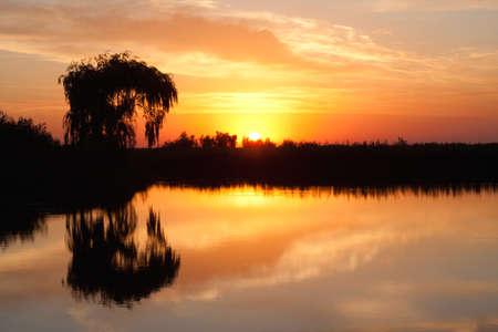sunrise scene on lake in a september morning