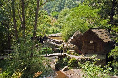 hause: The watermills of Valea Rudariei, District Caras-Severin, Romania, are a testimony of the traditional tehnology in Banat.  A number of 22 mills along the water course, inside and otside the village, still exists. The mills are operated by a horizontal whe Stock Photo