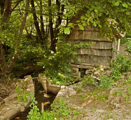 watermills: The watermills of Valea Rudariei, District Caras-Severin, Romania, are a testimony of the traditional tehnology in Banat.  A number of 22 mills along the water course, inside and otside the village, still exists. The mills are operated by a horizontal whe Stock Photo