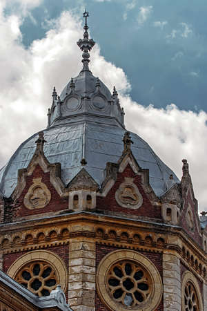 Facade and tower of a synagogue located in Timisoara, Romania photo