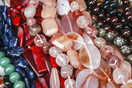 trinkets: Different colored trinkets displayed in the waiting customers.
