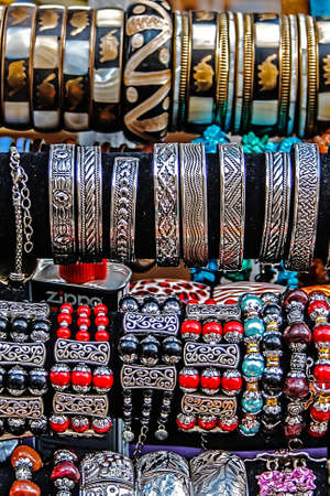 trinkets: Different colored trinkets displayed in the waiting customers