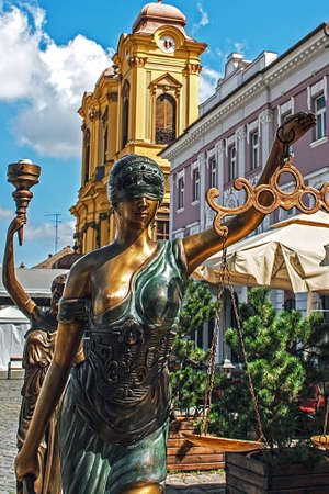 Old bronze statues representing justice and democracy