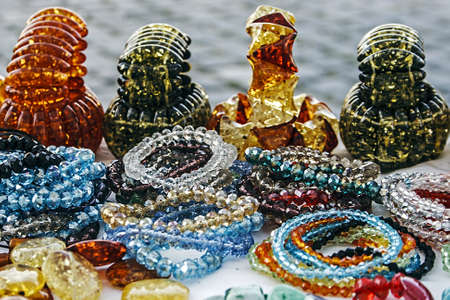 trinkets: Different colored bracelets and trinkets displayed in the waiting customers  Editorial