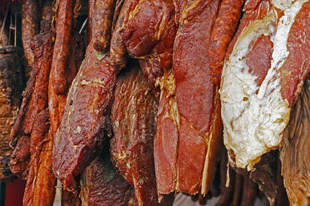 Various types of romanian beacon and sausages  carnati , smoked and dried, exposed for sale  Shall specify for the month of December Stock Photo - 16770291
