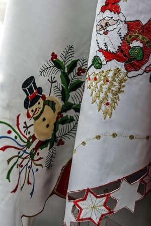 White tablecloths for Christmas dinner party, embroidered with various specific ornaments  photo