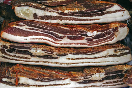 Pieces of smoked pork bacon and ham overlapping Traditional Romanian food, shall specify in the month of December Фото со стока - 17032464