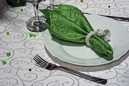Arrangement for festive dinners with plates, tableware and ornaments. photo
