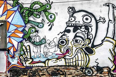 Bir sokak duvarında Fantezi çizim grafiti Stock Photo