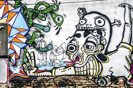 visual art: Fancy drawing graffiti on a street wall