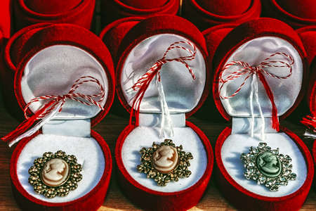 Martisor- symbol of the coming spring in Romania, Moldova, Bulgaria and Macedonia  This decoration is worn near heart during March month by women  Stock Photo - 18128778