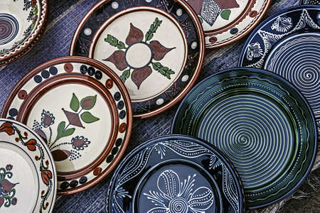 Romanian traditional pottery in the form of plates, painted with specific reasons Corund area, Transylvania  photo