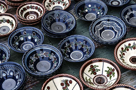 reasons: Romanian traditional ceramic in the bowls form, painted with specific reasons Corund area, Transylvania  Stock Photo