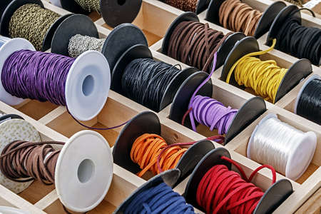 trinkets: Spools with chains and colored ribbons for made trinkets