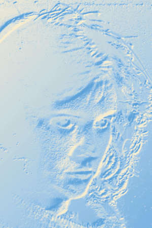 manipulated: Abstract blue background with a relief of feminine face  Image digitally manipulated  Stock Photo