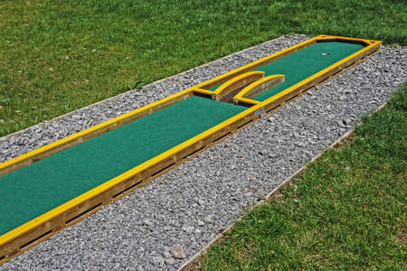 Small golf course built for children in a recreational space  Фото со стока