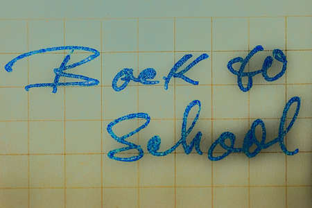 Inscription color slogan ,, Back to school   in a cheerful color blue with stars  Stock Photo - 22087476