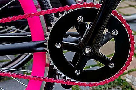 Detail of bicycle crank, red chain, derailleur and pink rear wheel   Stock Photo - 22664438