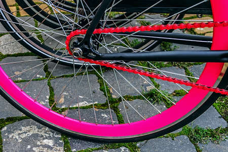 Detail of bicycle red chain, derailleur and pink rear wheel Stock Photo - 22664445