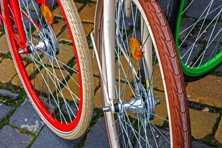 Detail with multicolored wheels to a group of bicycles  Stock Photo - 22664501