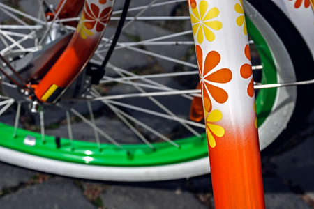 Detail of the front wheel to the bike with nice floral design  photo