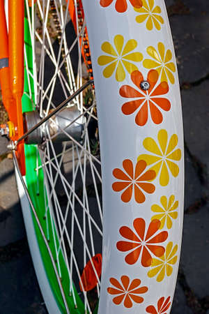 Detail of the rear wheel to the bike with nice floral design Stock Photo - 22664548