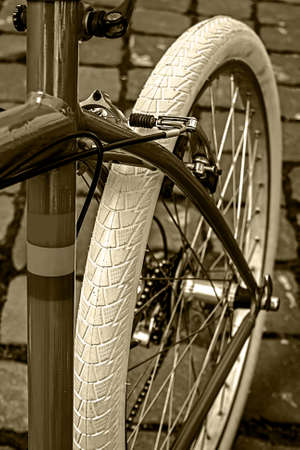 Detail of vintage bicycle frame, chain, brake, derailleur and rubber rear wheel Stock Photo - 22664577