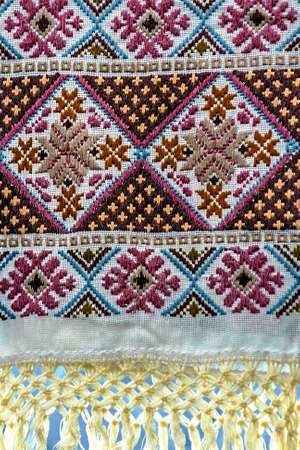Materials and embroidered Romanian traditional port specific  Stock Photo