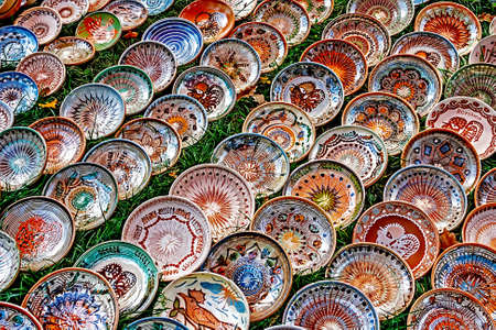 reasons: Romanian traditional ceramic in the plates form, painted with specific reasons Horezu area